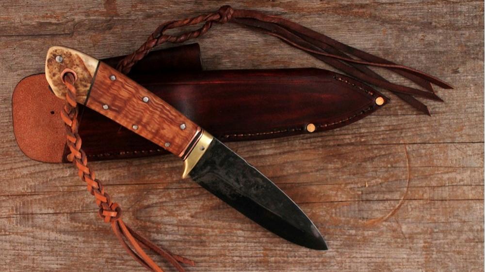 Custom handmade bushcraft knife. Scandi edge.