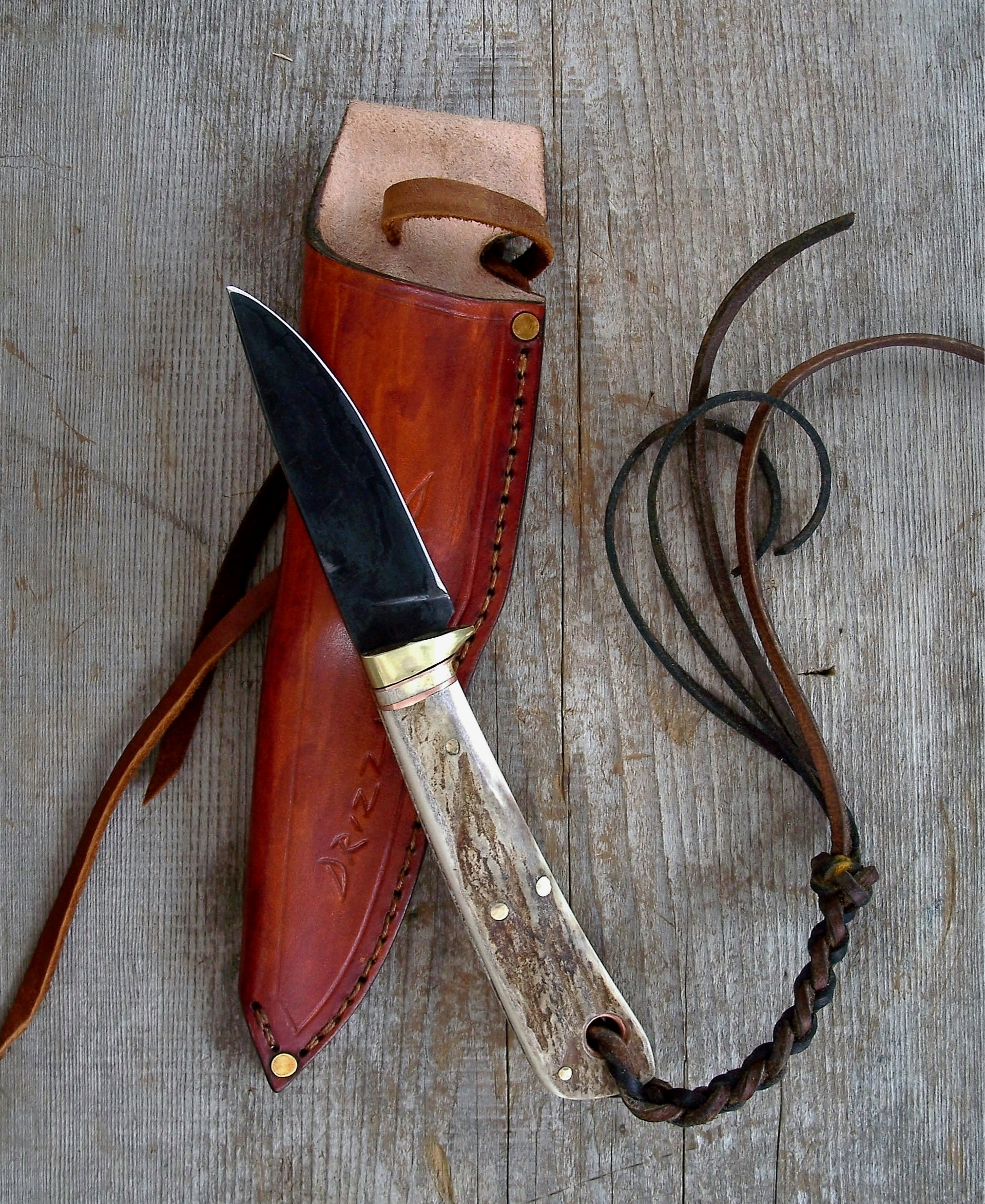 Handmade hand forged drop point knife. Custom made Horseman's knife.