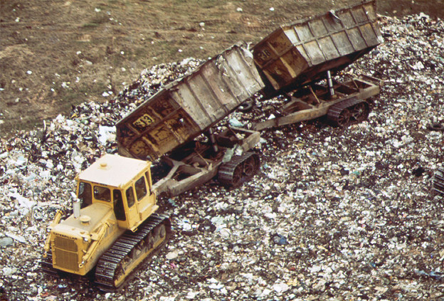 Trucks dump garbage at Fresh Kills Landfill, May 1973. Photo by Chester Higgins with the EPA, via Wikimedia Commons.