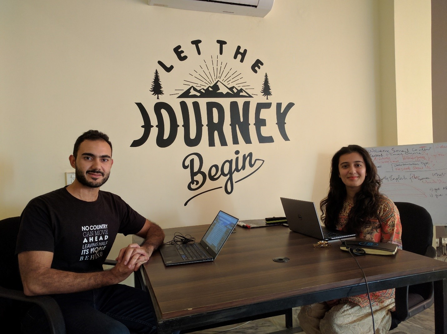 """""""Working from Kickstart, a co-working space in Lahore. It was only befitting to sit in front of a wall that said, 'Let the Journey Begin'."""" -Madiha Nasrullah"""