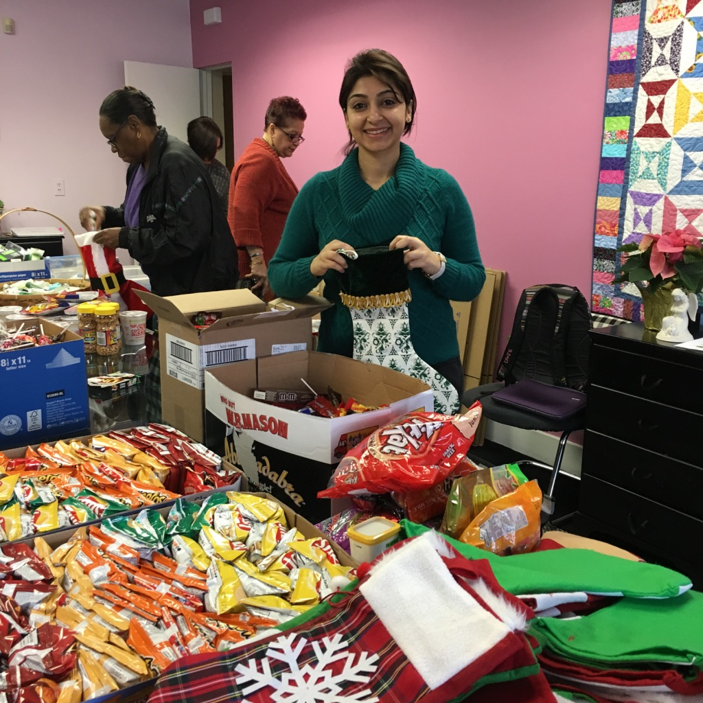 Packing Christmas gifts at Angels of Mercy.