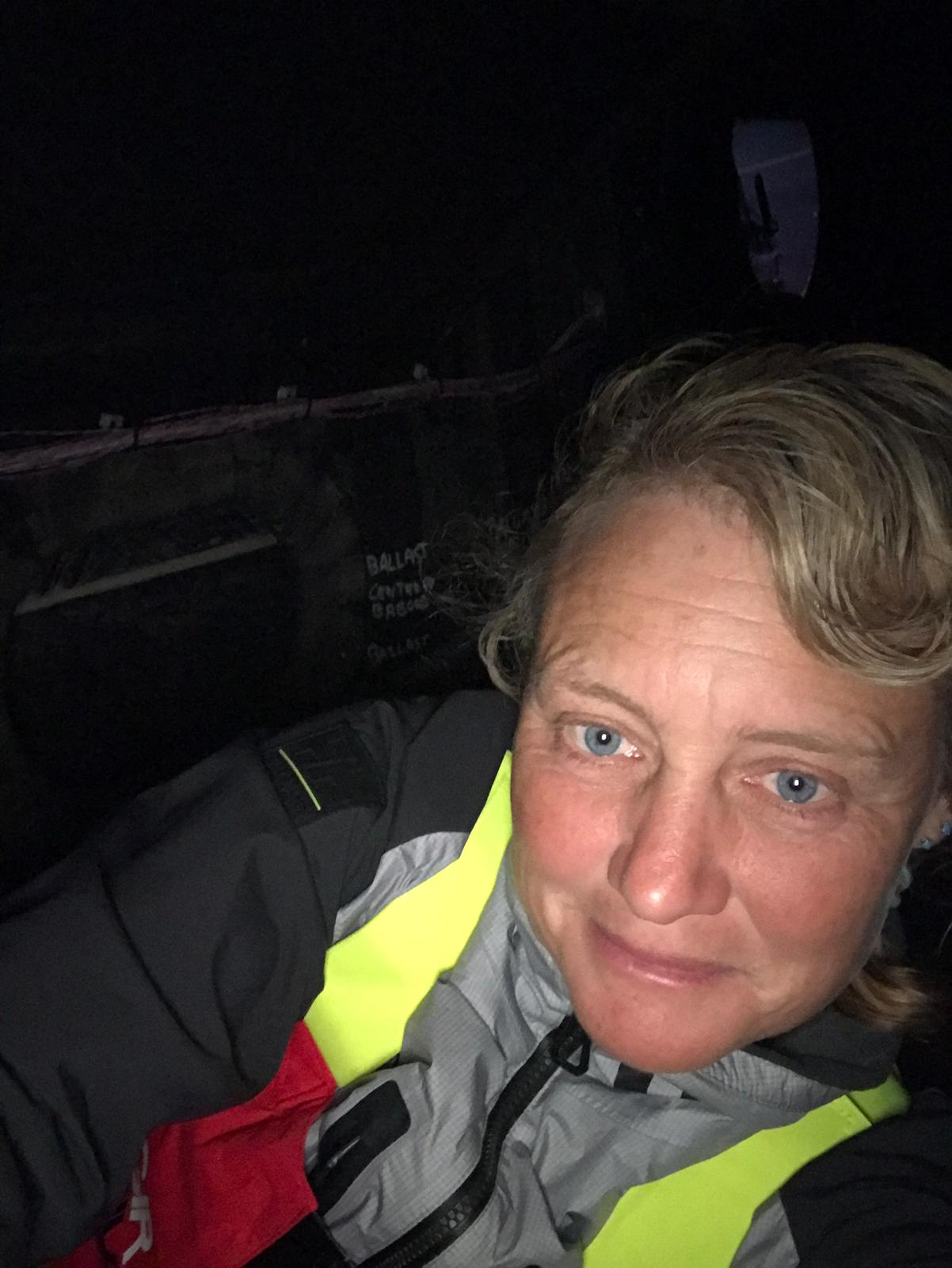 Crawling around in a dark small space. When the boat slams on waves it's like being inside a drum. Over my shoulder you can see the pipes for pumping out each compartment.