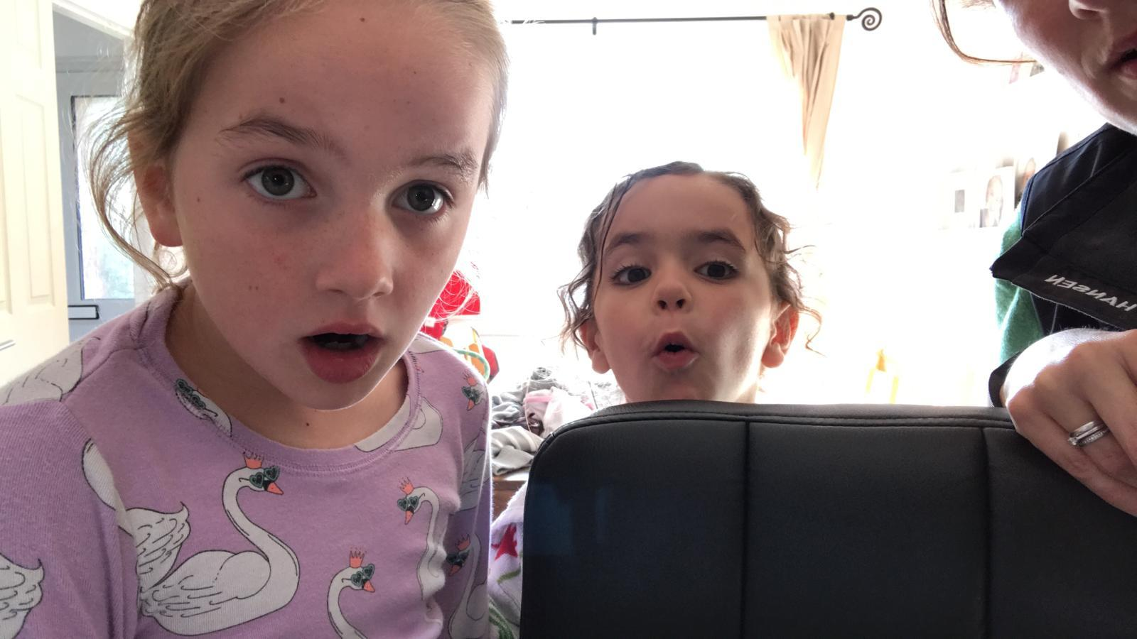 Bethany (8yo) & Amelie (5yo) watching a video Pip sent to them of dolphins playing around Superbigou.