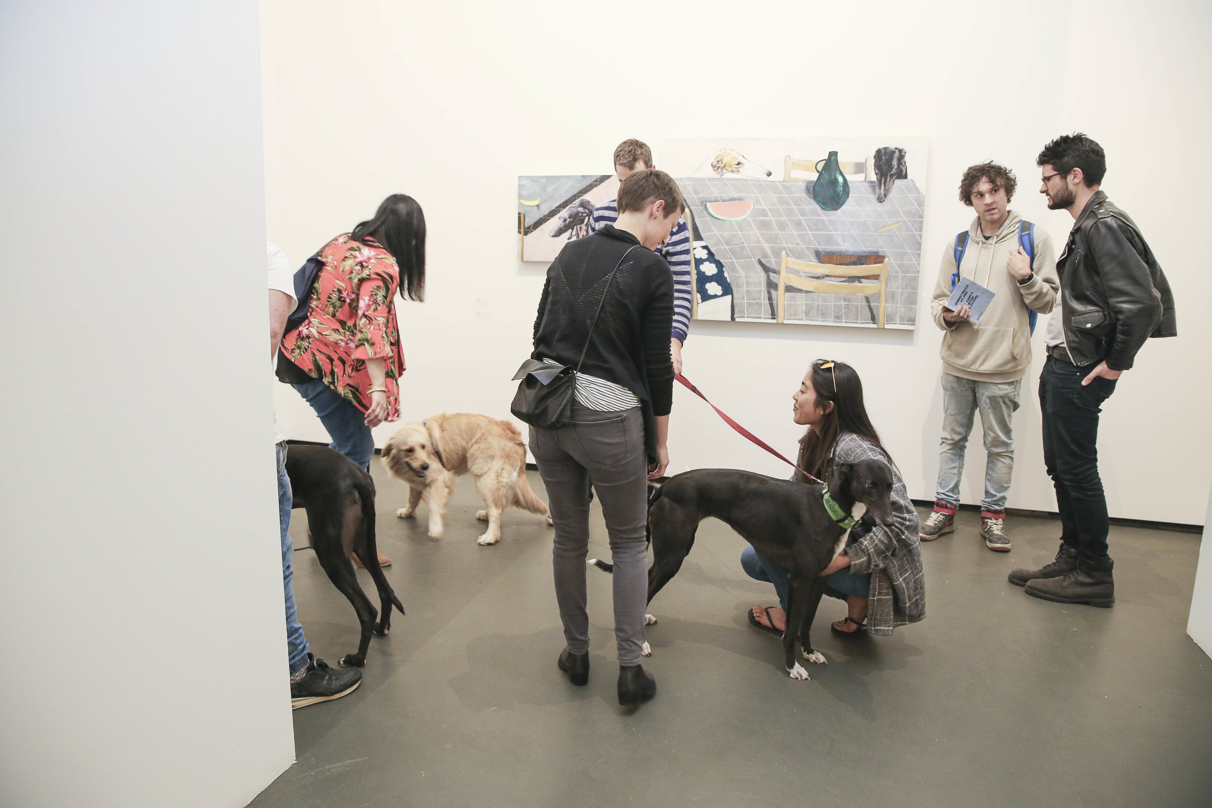 Visitors at the exhibition launch,  Every Dog Will Have its Day,  2017, Casula Powerhouse Arts Centre, Sydney. Photo: Andrea Todic
