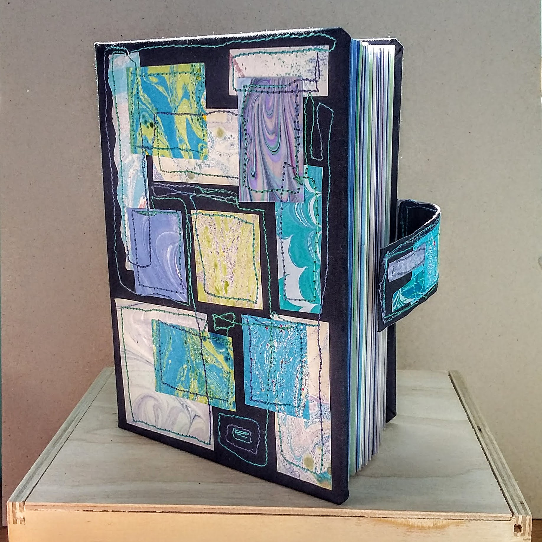 Blue marbled book with magnet closure A6 size. 11.5 x 15.5 cm. 140 sides, 70 pages. £30 plus p&p