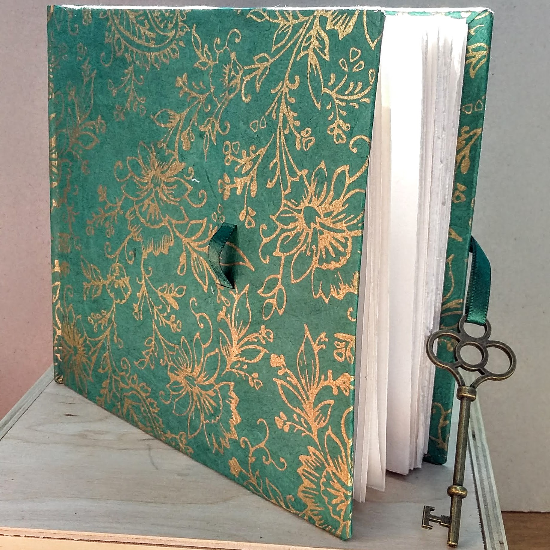 SOLD Square key closure book. 16 x 14.5 cm. 92 sides, 46 pages.