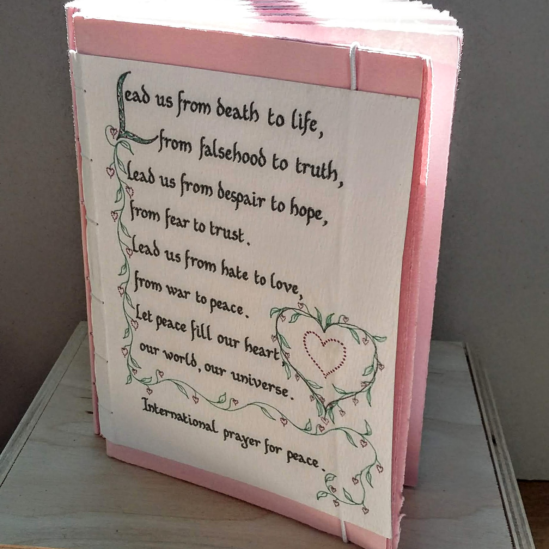 Pink peace prayer book, closes with elastic round the back A6 size. 15 x 11 cm. 128 sides, 64 pages. £20 plus p&p