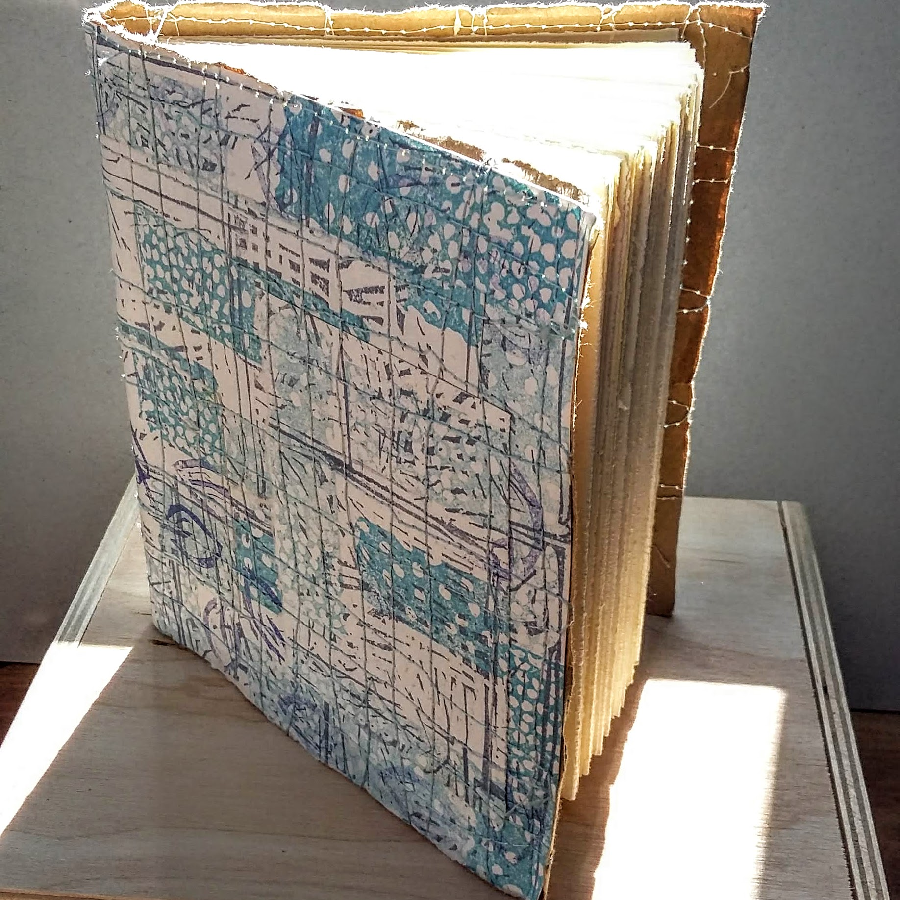 Printed blue book with machine embroidery. 12 x 14 cm. 124 sides, 62 pages. £30 plus p&p