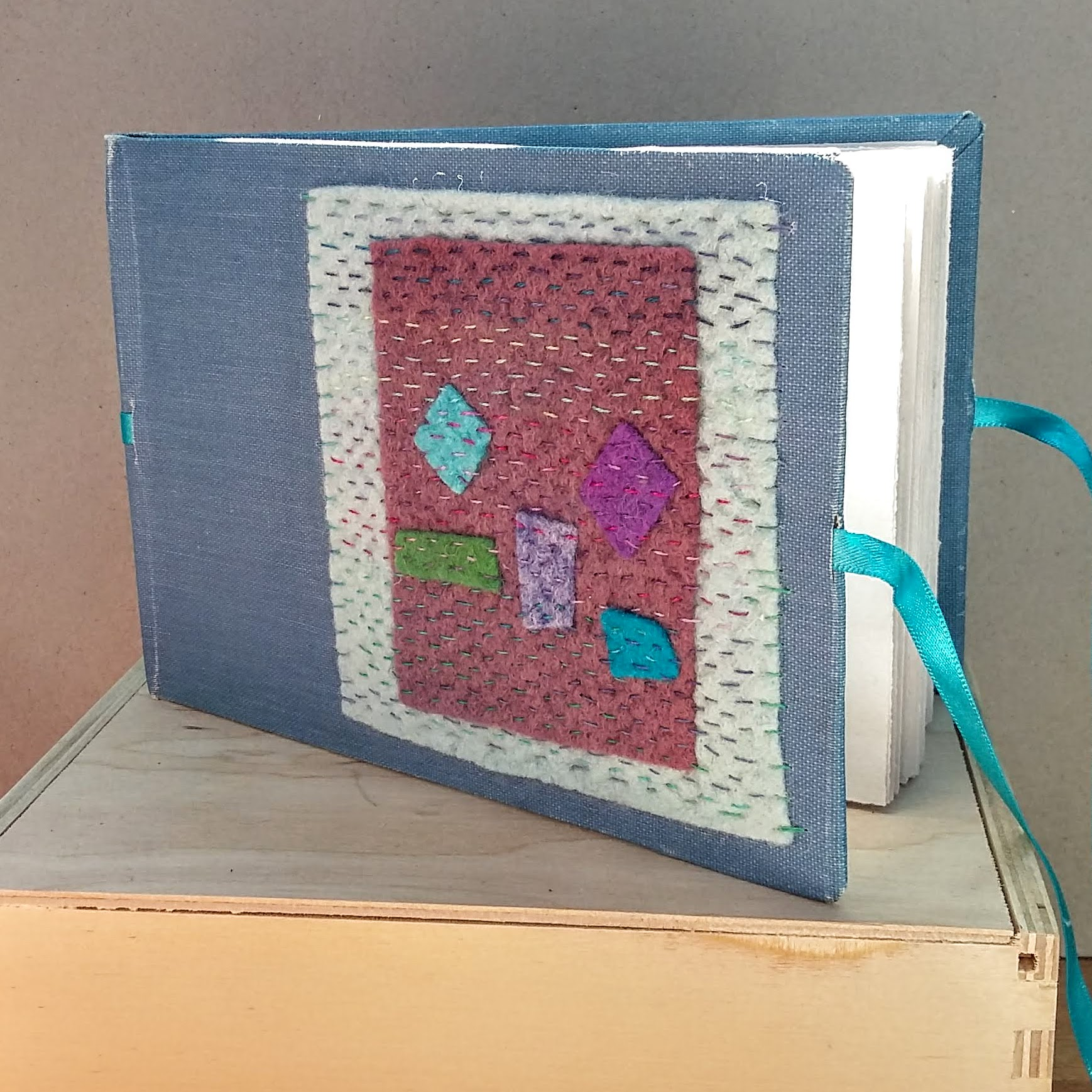 Felt landscape book with ribbon ties A6 size.  16 x 11 cm. 100 sides, 50 pages. £40 plus p&p