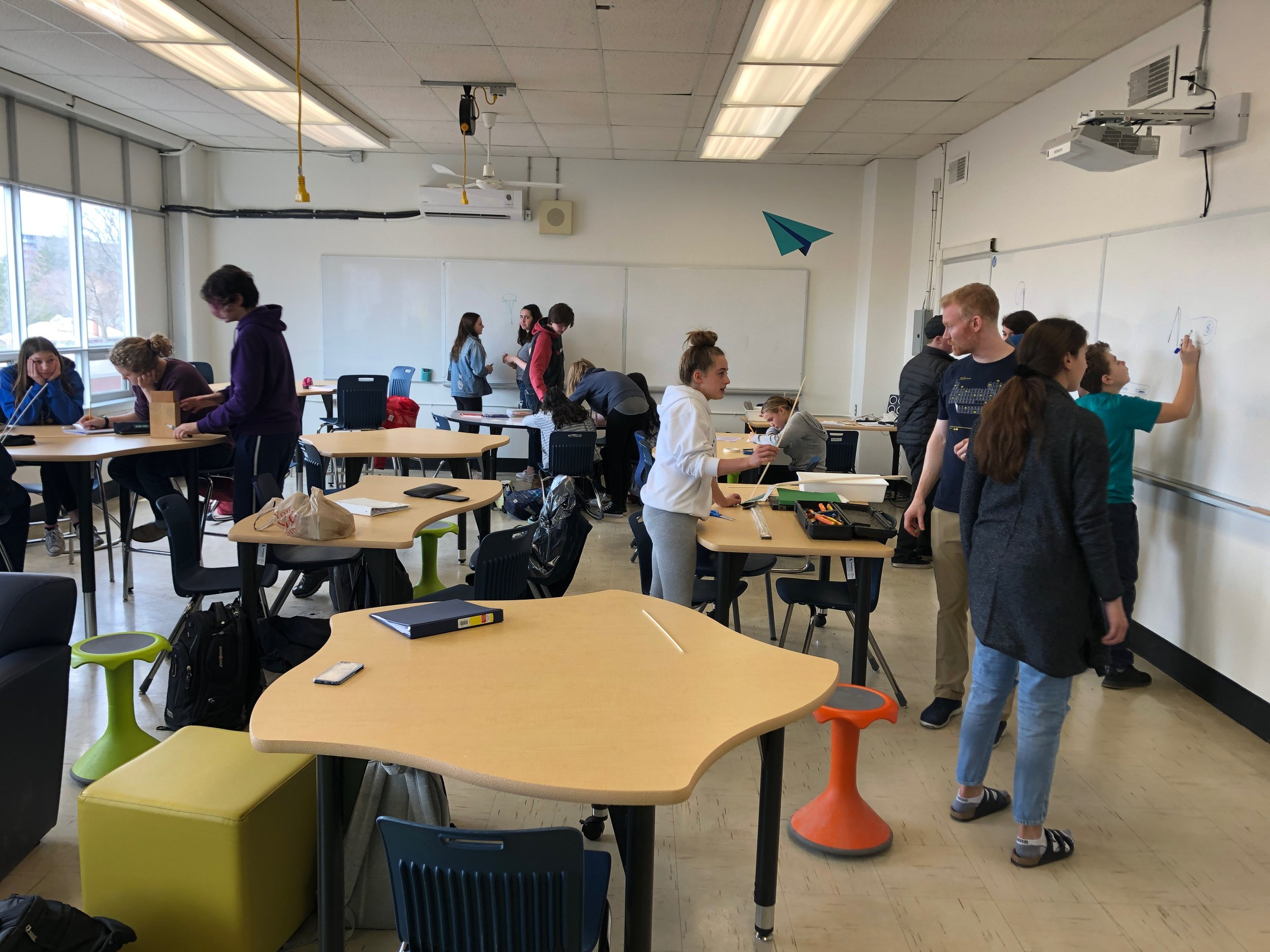 Grade 9 Students designing in the WONDER room in the Burlington Central SHIFT space