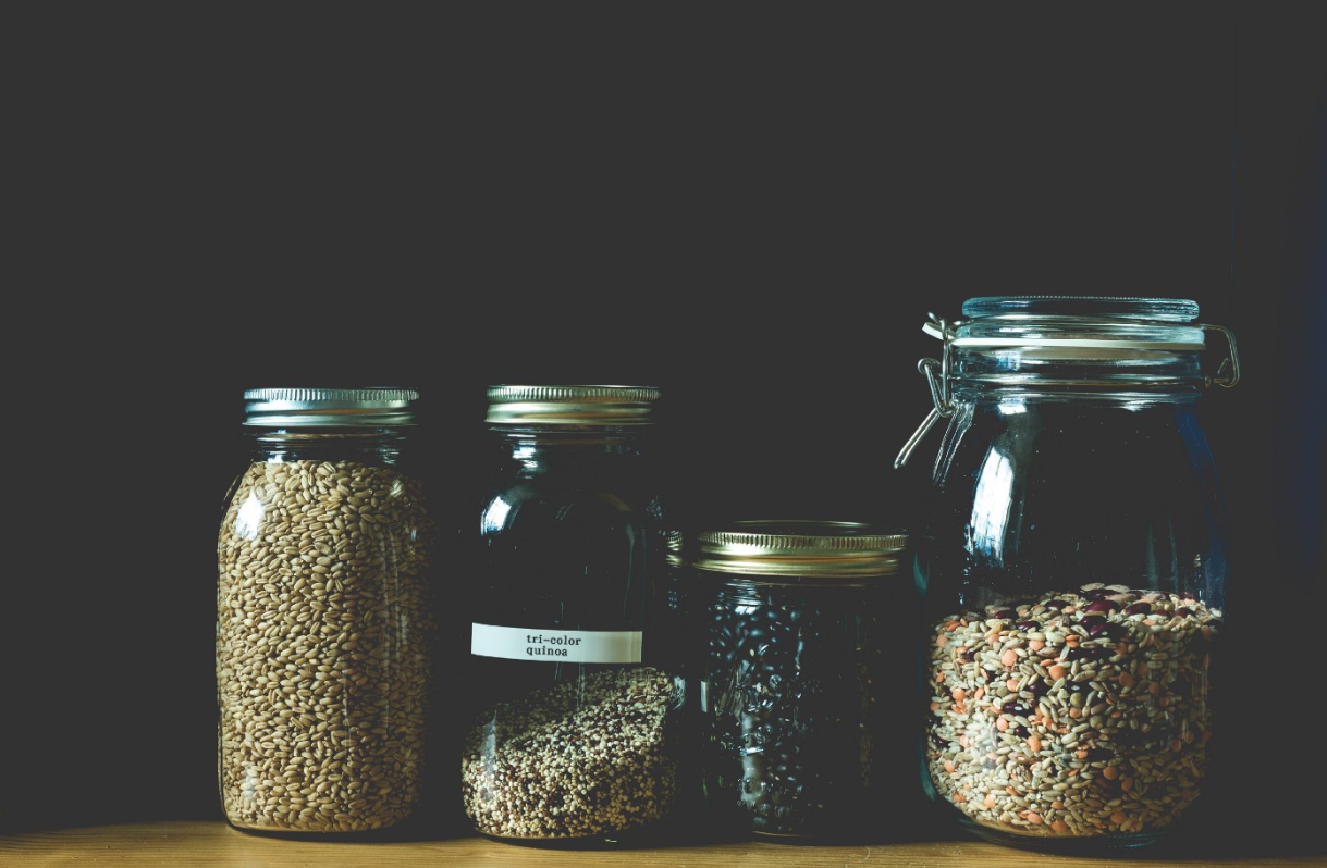 """four clear jars filled with grains"" by  Denise Johnson  on  Unsplash"