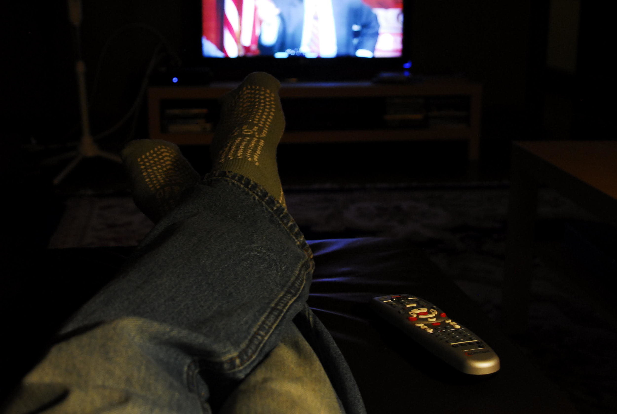 Buck's feet resting in front of the TV