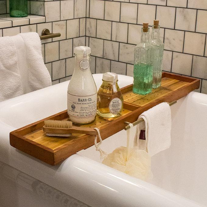 Bath Caddy - Who doesn't love the idea of taking a hot bath at the end of every evening? This is one of the best ways to relax and get inspired for a new day. One thing that makes a bath more enjoyable is this Bath Caddy. It's perfect to hold your glass of wine, your phone or a new book. It makes for a wonderful way to relax. This is a nice bath caddy too!(affiliate link included)