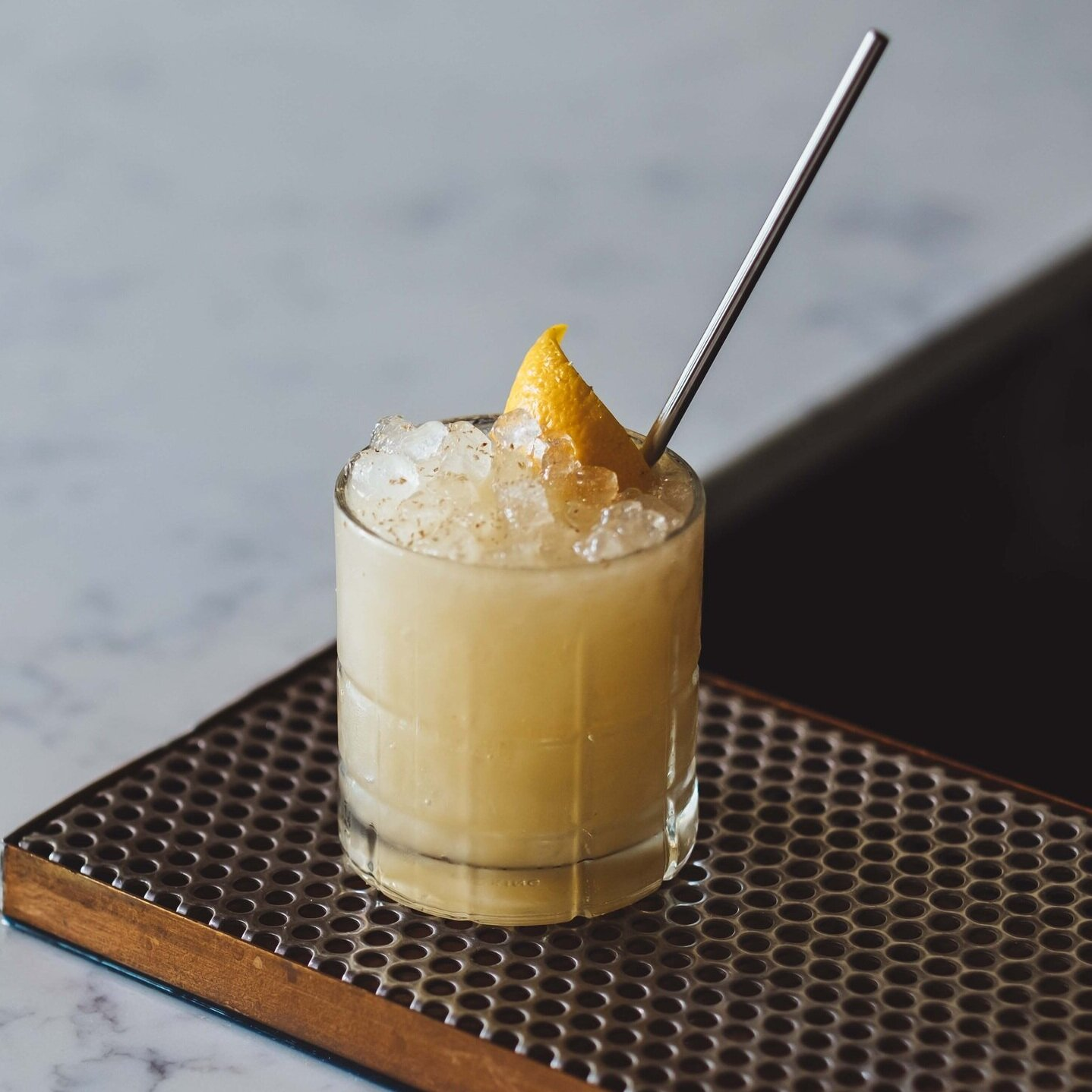 Featured Cocktail: Just Another Corpse Reviver - with Cognac VS, Pere Magloire Calvados, Dolin Blanc, Macadamia nut milk, orgeat and cardamom bitters