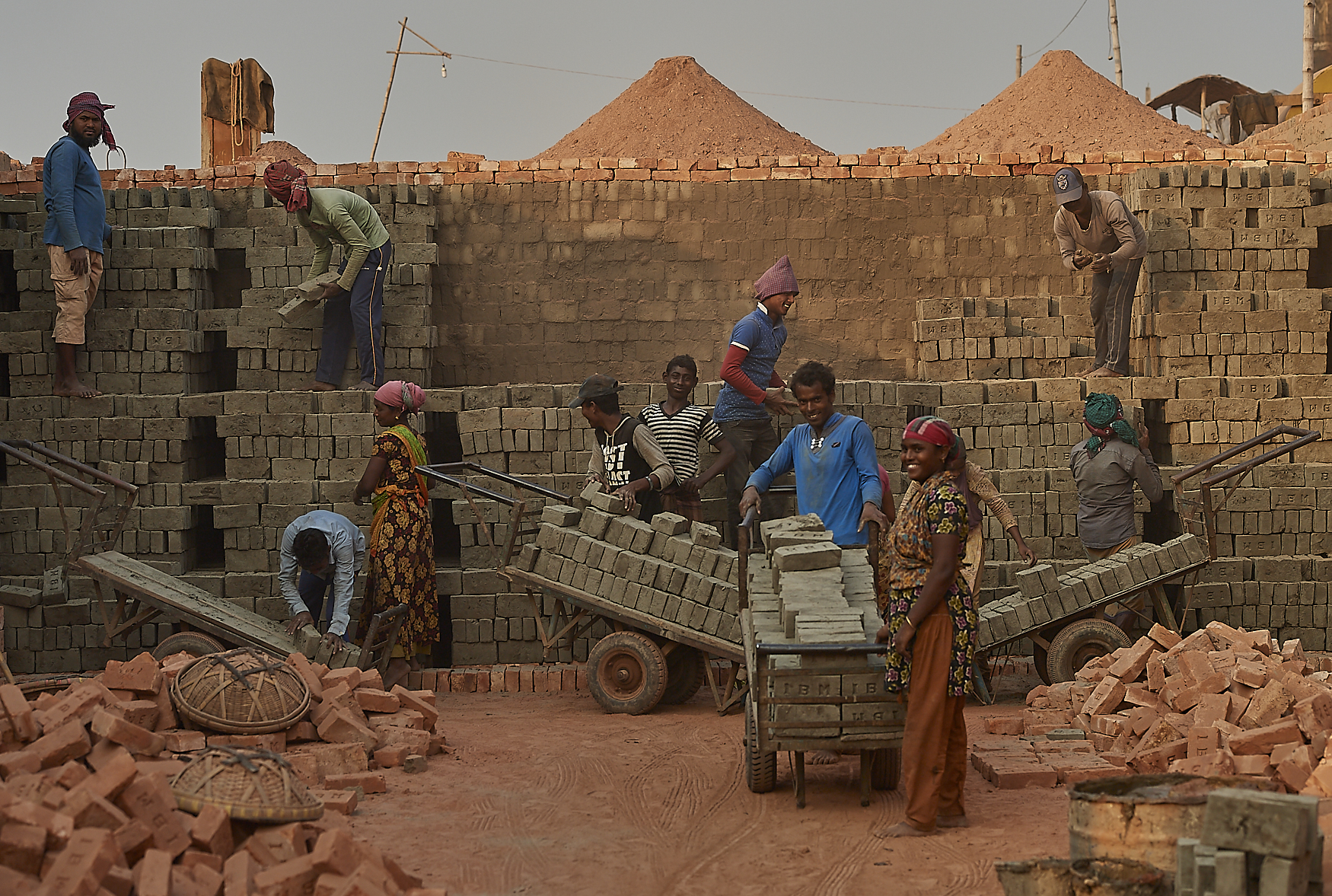 Brick factory workers sometime work as entire families, including men, women and children, each in distinct roles