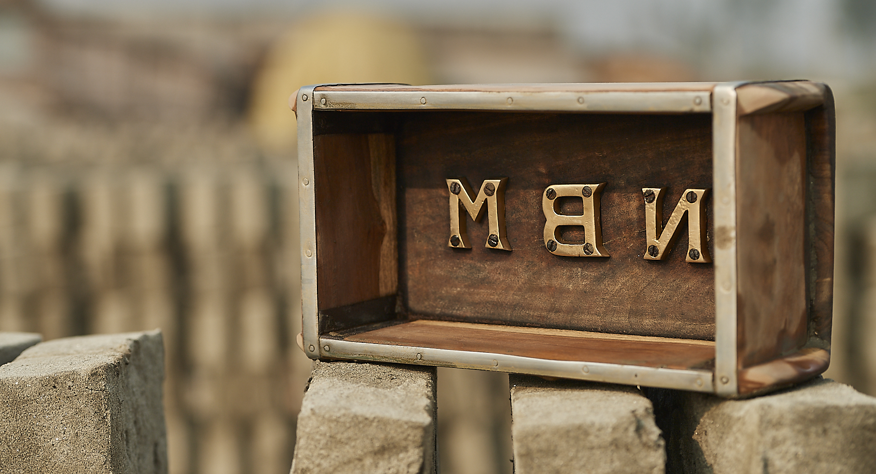 a brick mould with the factory name embossed in brass