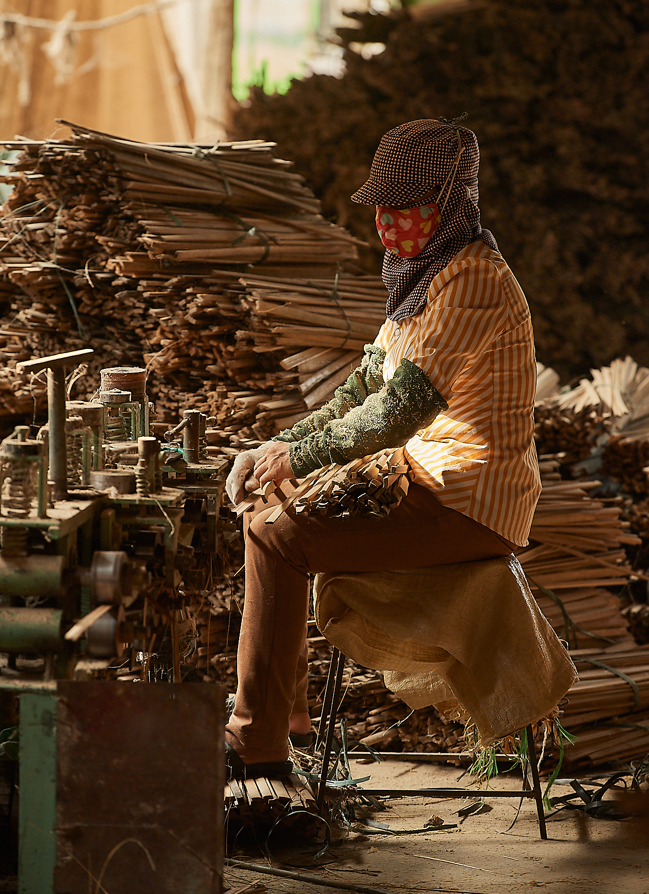 Sticks are being fed through the machine until they are smoothed out and in the appropriate dimensions.  In the process, all excess material is discarded.