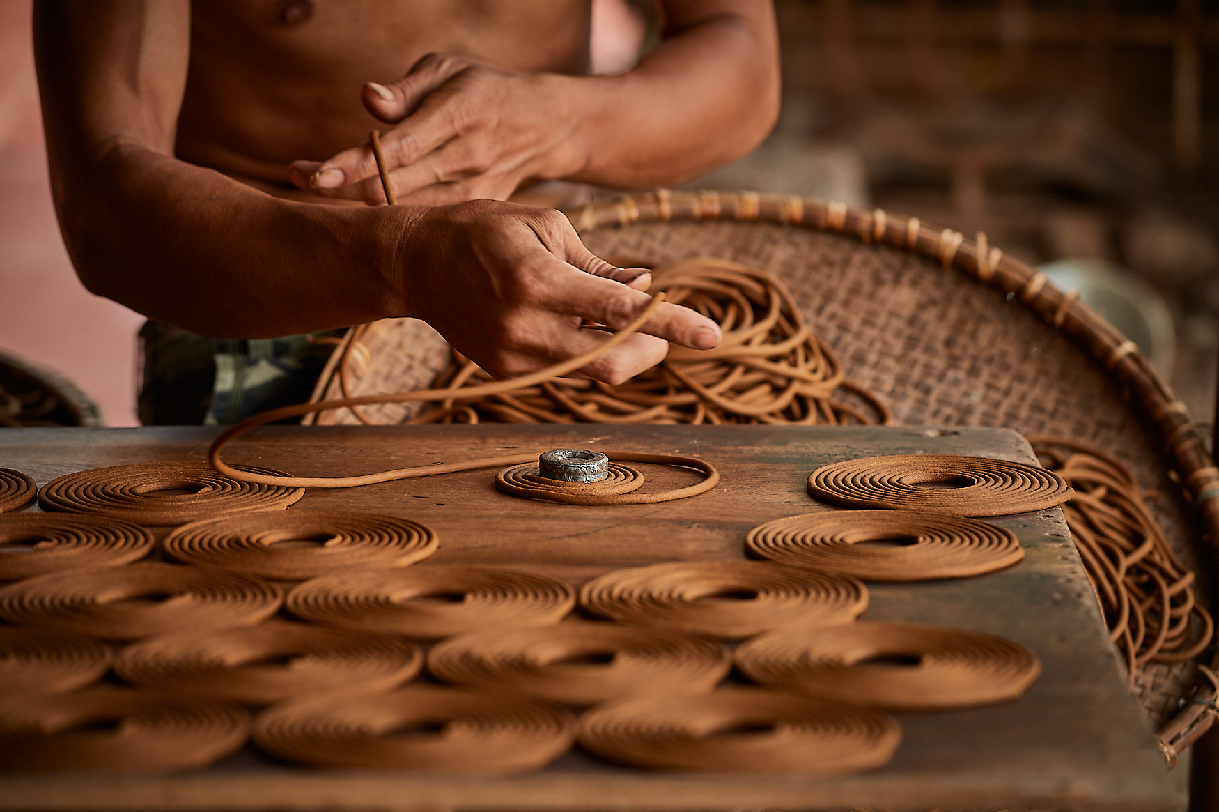 Circular incense pyramids are rolled by hand