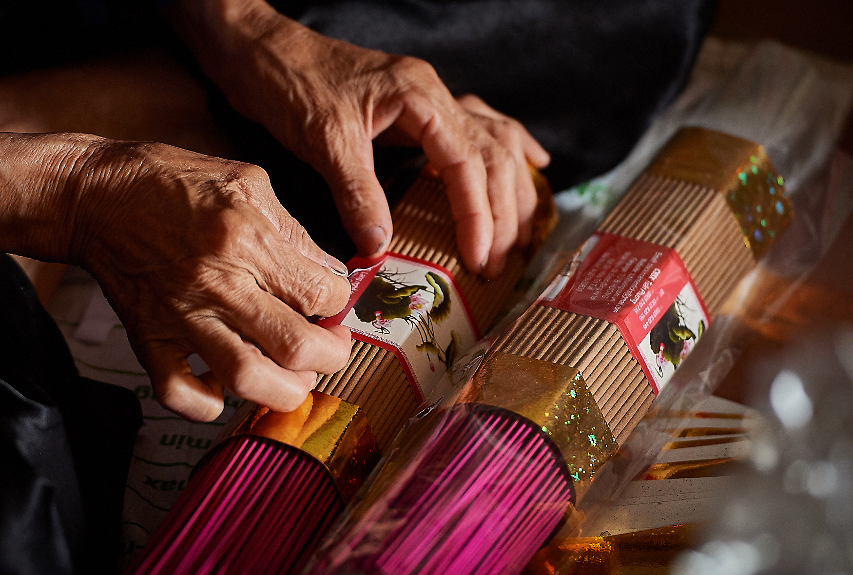 It's usually older women who package the incense sticks for shipping