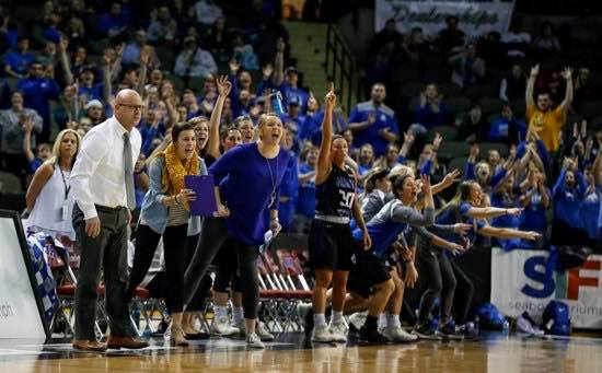 Student coach Jill Ricke, SFLS class of 2012, cheers the Dakota Wesleyan University Tigers on from the sidelines during the 2018 NAIA Division II tournament.