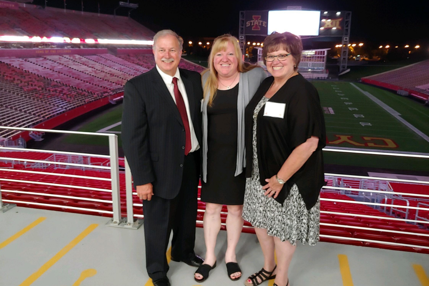 Lisa Griebel (Agar) poses with her former SFLS teachers, Rod and Tina Lenz, at the September 14 Iowa State University Hall of Fame Induction Ceremony.