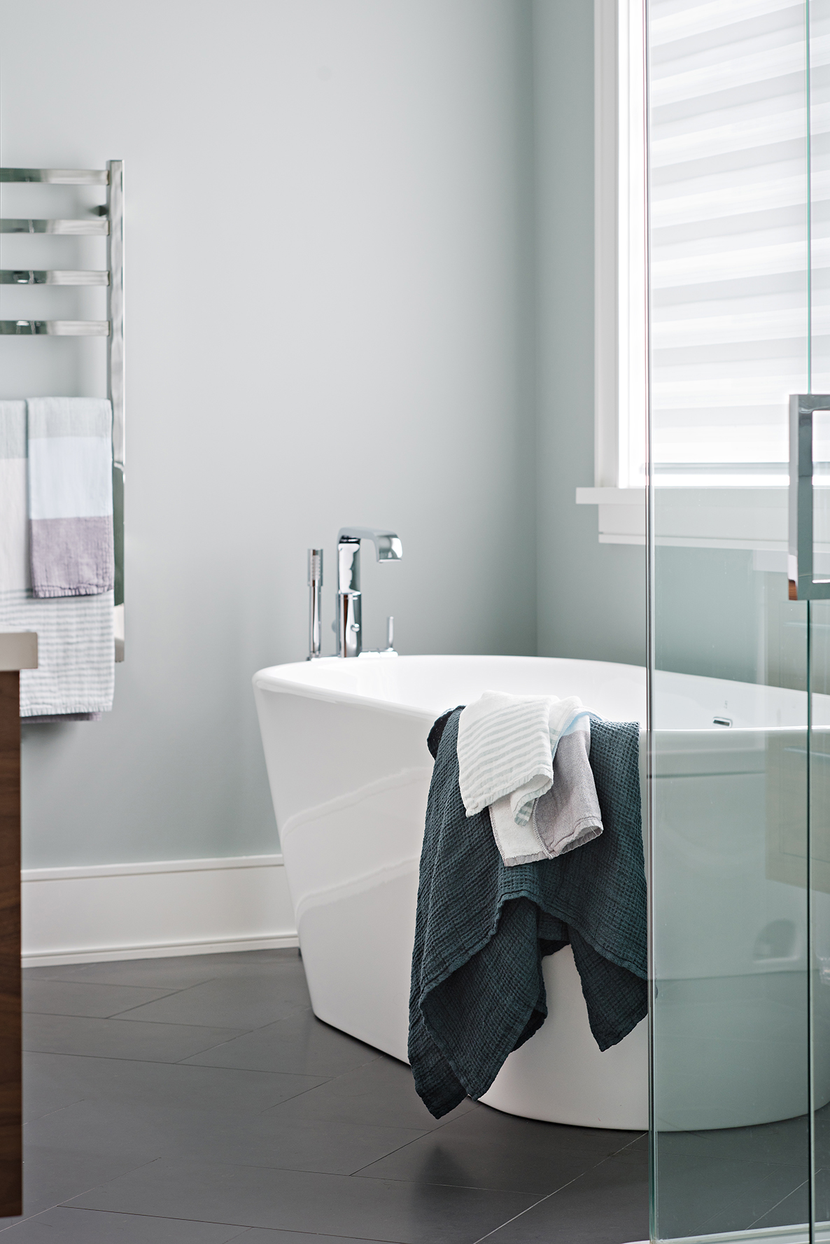 Deep soaker tub in master bathroom retreat designed by Four Blocks South residential interior designers based in Toronto, Canada.