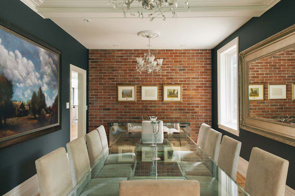 Stunning glass dining table; brick accent wall. Interior design by Four Blocks South, residential interior design firm based in Toronto, Canada.