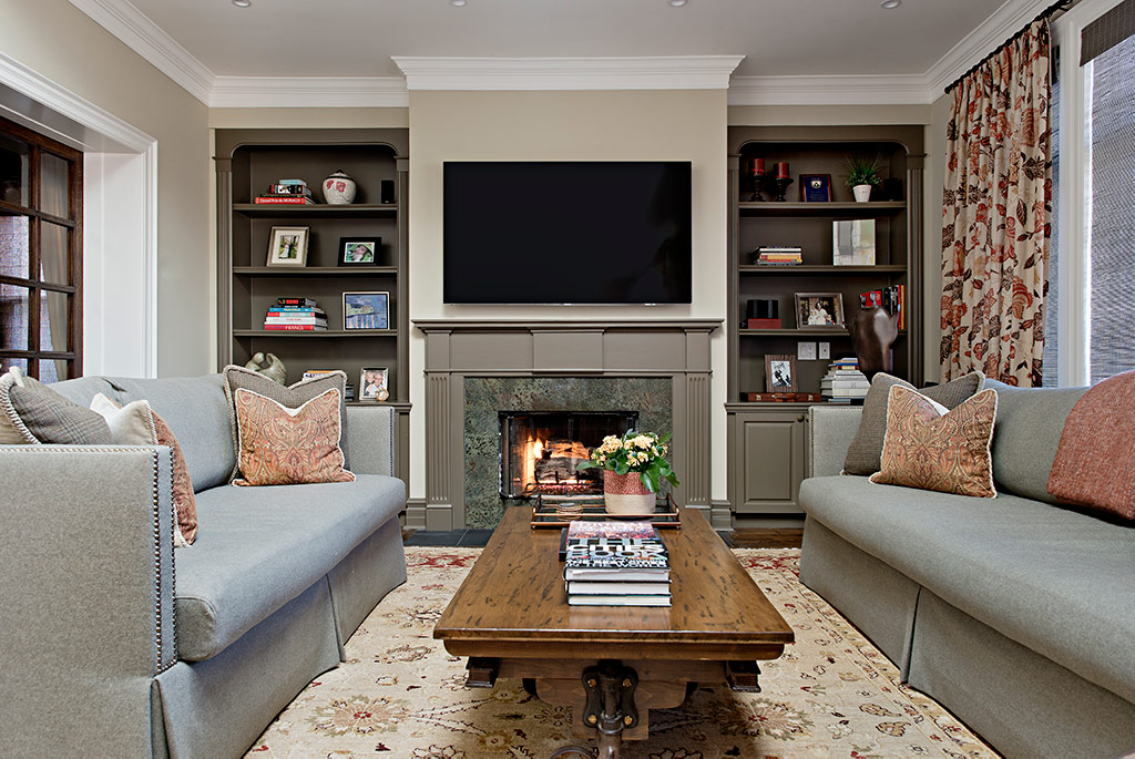 Rosedale living room with fireplace and mounted tv