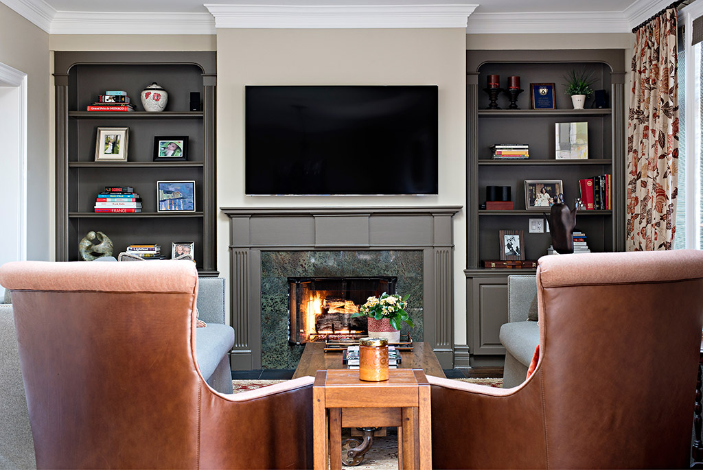 Rosedale living room with mounted tv above fireplace