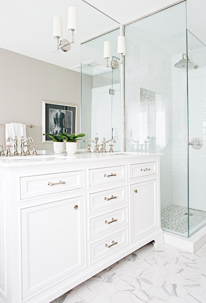- In the bathroom, we used refined, classic tiles and sophisticated plumbing fixtures, cabinetry and lighting.