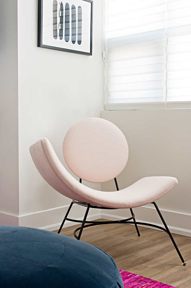 Stunning modern accent chair in light pink is a functional conversation starter in this downtown loft design.