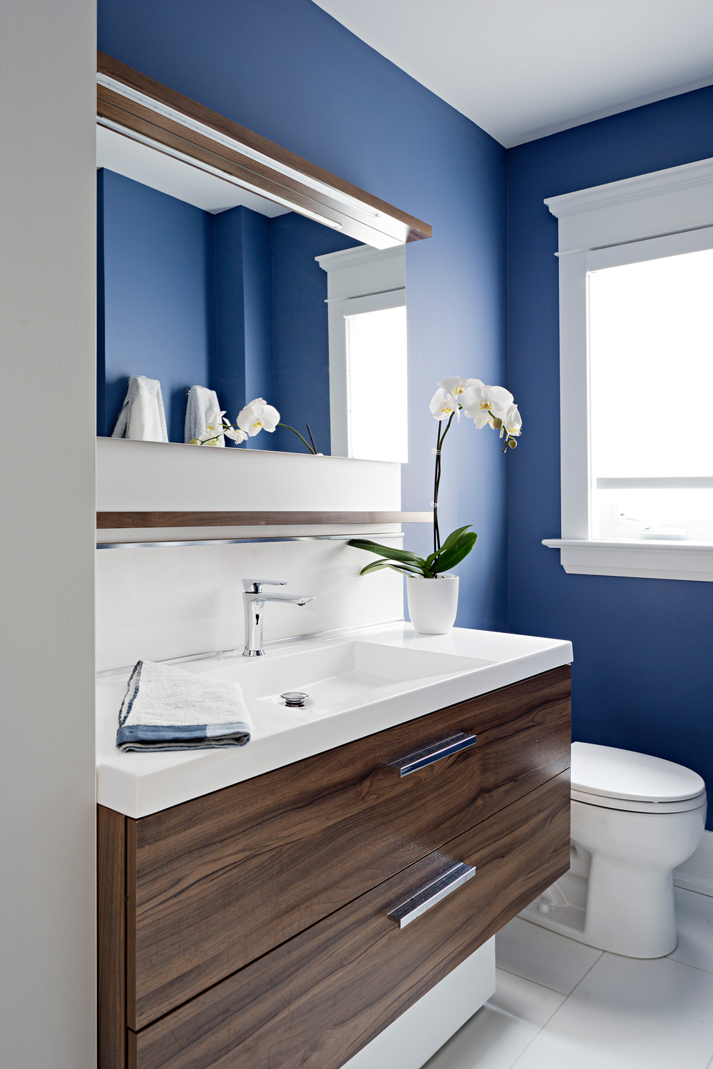 Small family bathroom with lots of hidden storage.