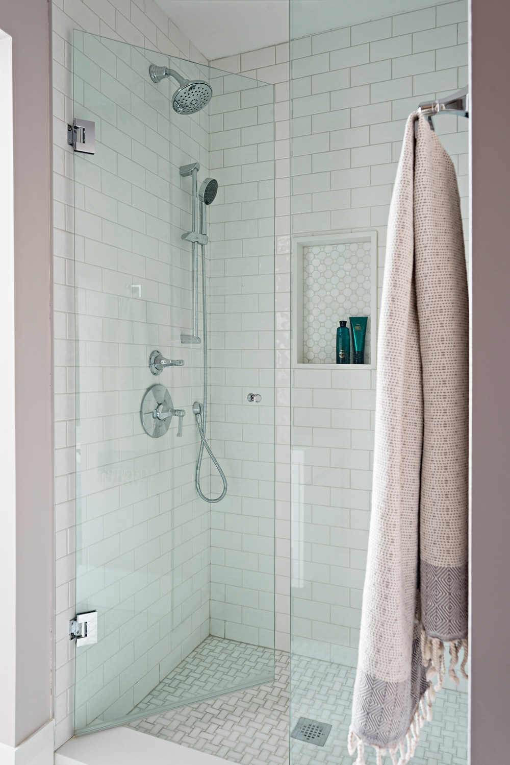 Master bathroom shower with mosaic tiles