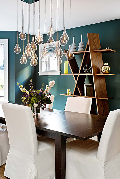 Add some drama to your dining room by using bold paint colour