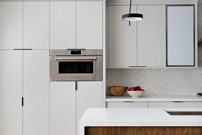 kitchen-panel-fronts-herringbone-backsplash.jpg