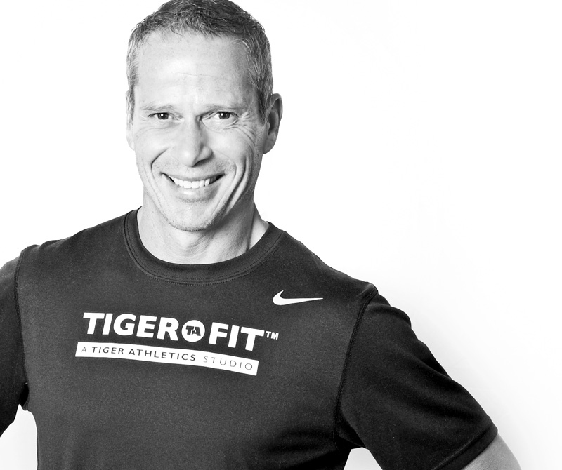 CHRIS CLARK - Co-Founder/ ICON Global Brands Fitness Expert & Consultant; Consultant to the Minnesota Vikings. Chris is a certified coach and trainer with a degree in bio-mechanics and a broad athletic coaching experience ranging from youth to Sports Team Training to Collegiate and Professional Athletes. His background in athletics, coaching and professional sports development spans over three decades and earned him an outstanding reputation in athletics.In everything he does in and out of the studio, Chris implements the 4 training pillars in the Tiger Method: mindset, movement, nutrition & regeneration. A three-time All American athlete, Chris has trained some of the best elite athletes in the field, and thoroughly enjoys training youth and inspiring them to be the best athletes they can be in their chosen sports.Resume includes, but not limited to: Minnesota Vikings Chad Greenway, Kyle Rudolph, Jeff Locke; Minnesota Timberwolves Team, Martell Webster, Minnesota Timberwolves Guard-Forward; IU Men's Basketball Team with Coach Bob Knight; IU Mens's Soccer Team with Coach Jerry Yeagley; Kevin Garnett, Minnesota Timberwolves & Boston Celtics Forward; Rex Grossman, Chicago Bears Quarterback; Ben Utecht, Indianapolis Colts & Cincinnati Bengals Tight End; Adam Weber, Minnesota Gophers Quarterback; Travis Bush, Minnesota Gophers Basketball & 2005 Minnesota Mr. Basketball; Ray Cowles, Hopkins High School & Santa Clara University Basketball; Kristy Wendel, Minnesota Gophers Hockey & US Women's Olympic Hockey Team; Winny Brodt, Minnesota Gophers Hockey; Minnesota Made Hockey Teams 97-01; Fire Team 97.