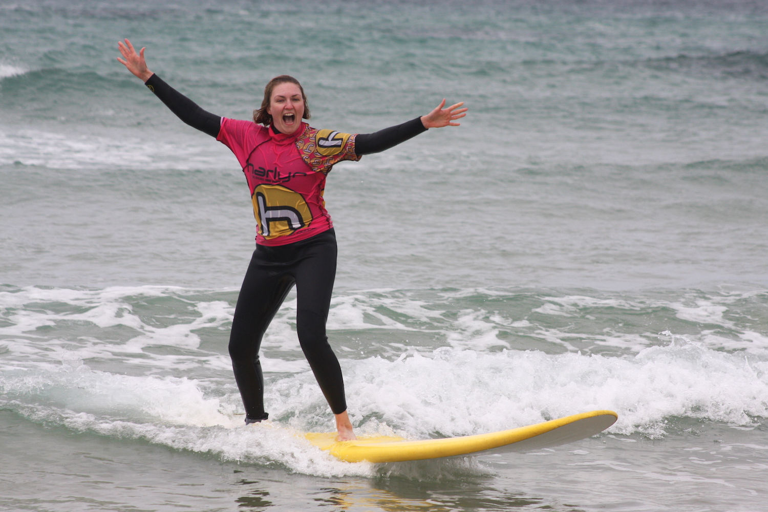 ride-on-retreats-happy-surf-girl.JPG