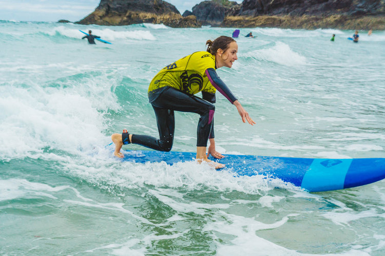 Learning to surf in a fun supportive group!