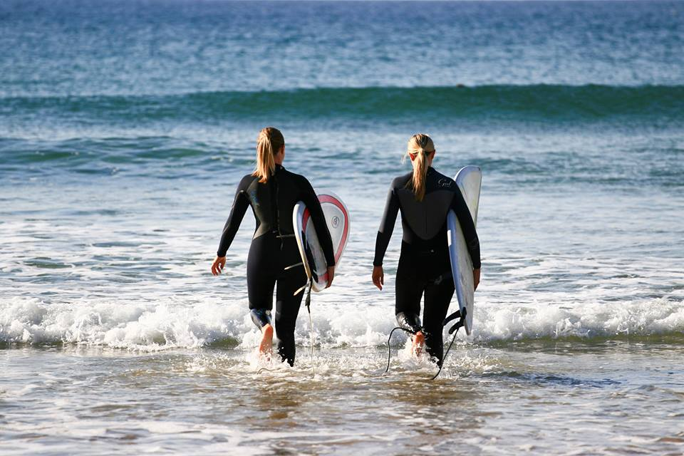 Heading out to surf at Watergate Bay….
