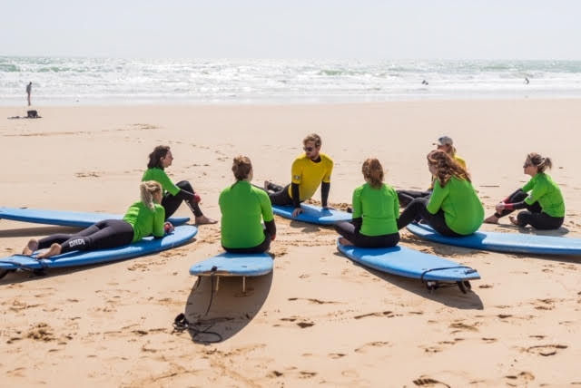 Group beginner surf lessons on our retreats