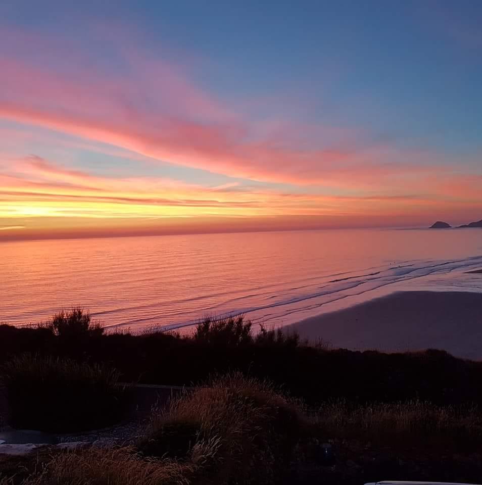 Ride-on-retreats-perranporth-surf-yoga-sunset-view.jpg