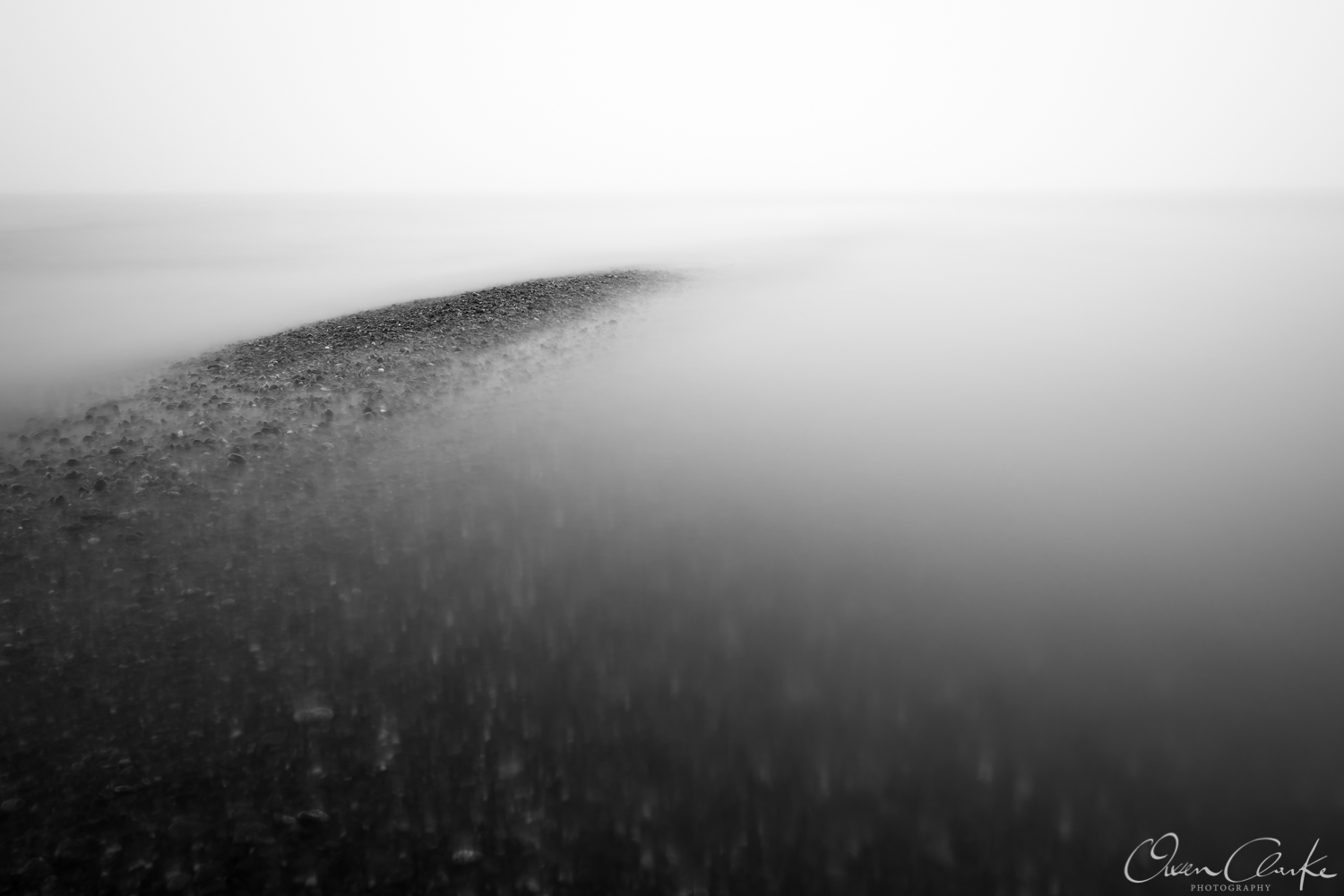 I watched as the tide slowly began to swallow up the shingle. It began to create a small island and what really caught my attention was how the tide was interacting with the shingle. A long exposure helped smooth out the ripples of the waves.