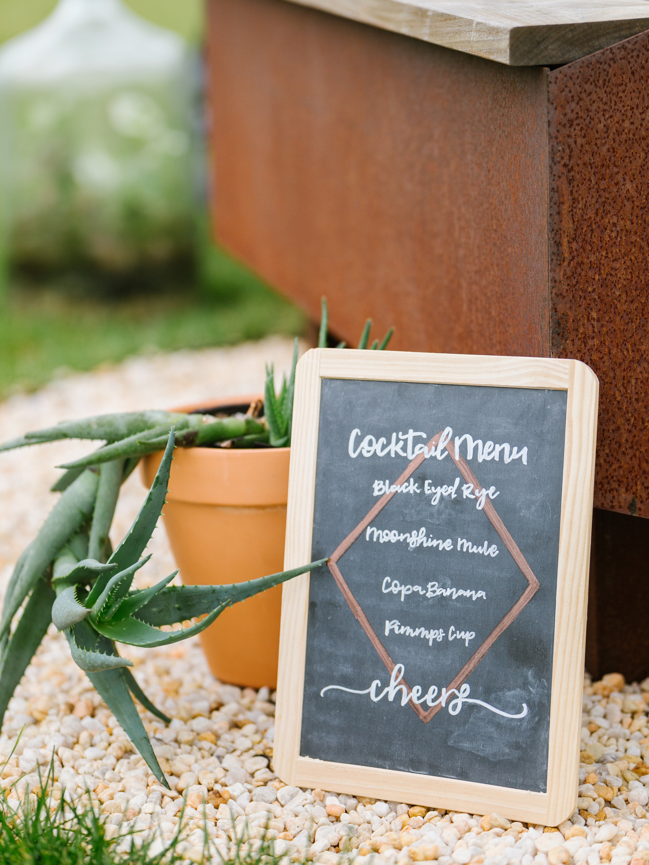 SIGNAGE - Wood, chalkboard, mirror, acrylic, and banner signage for local weddings and events.
