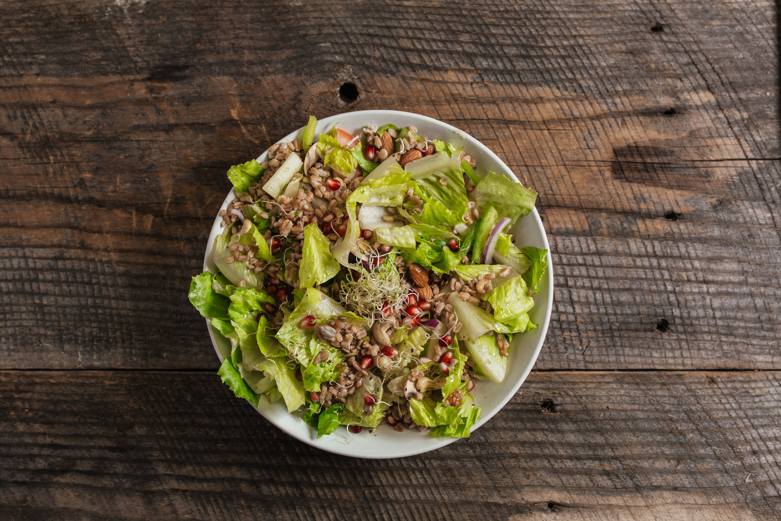 Healthy farro salad vegan recipe plant based pomegranate and seeds sprourts
