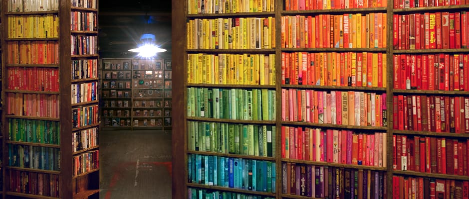 Shelves of rainbow colored books