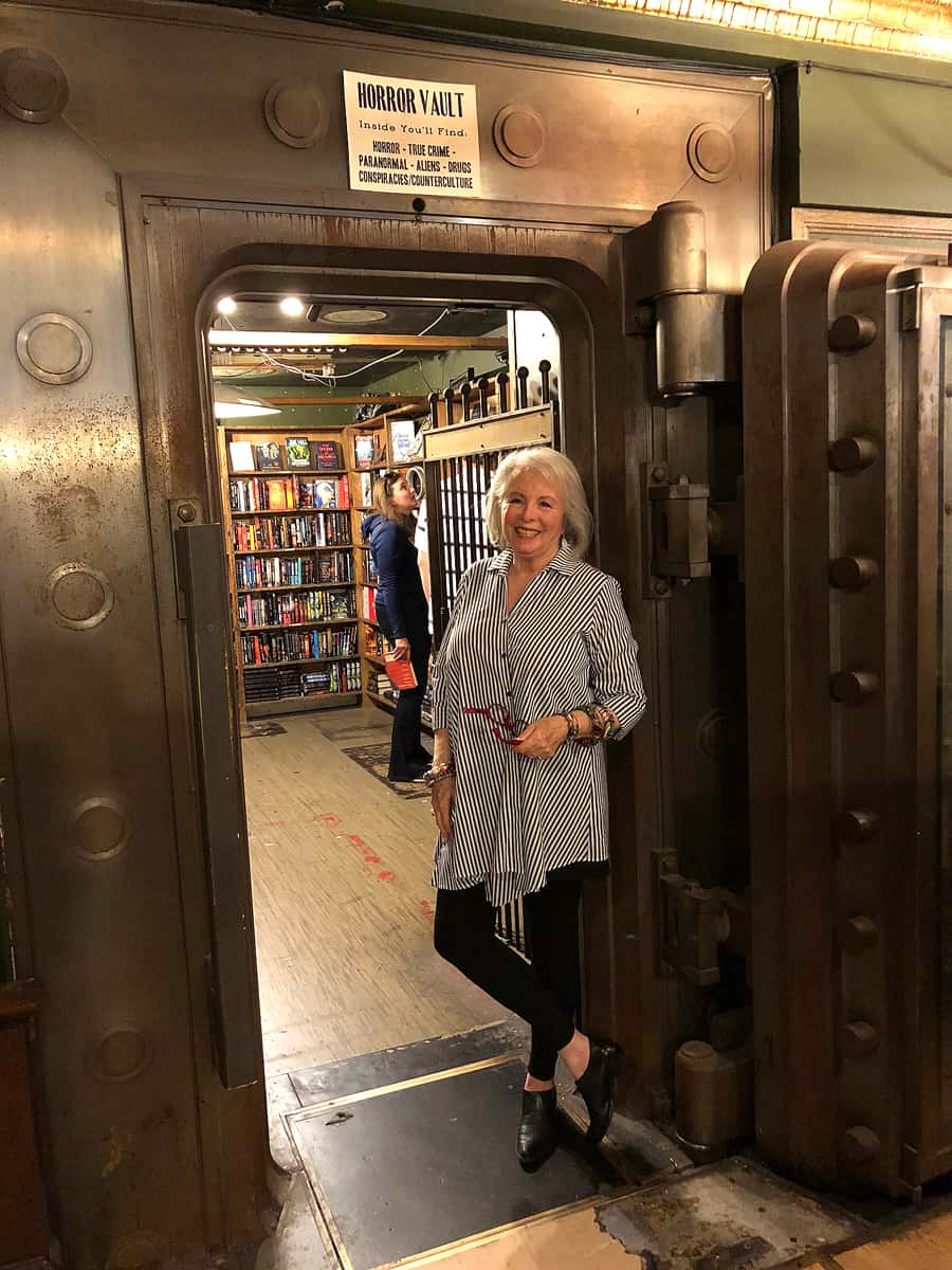 Sandra at entrance to vault with Horror books