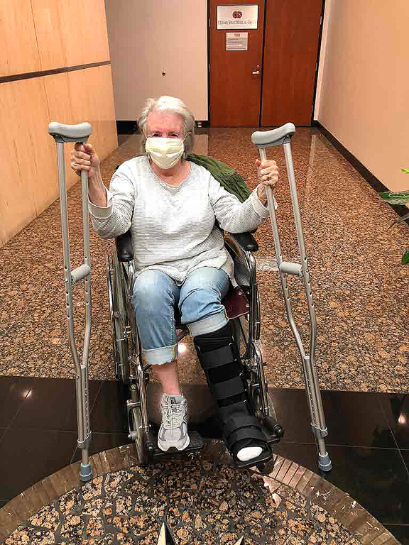 Sandra with crutches and wheelchair in Urgent care