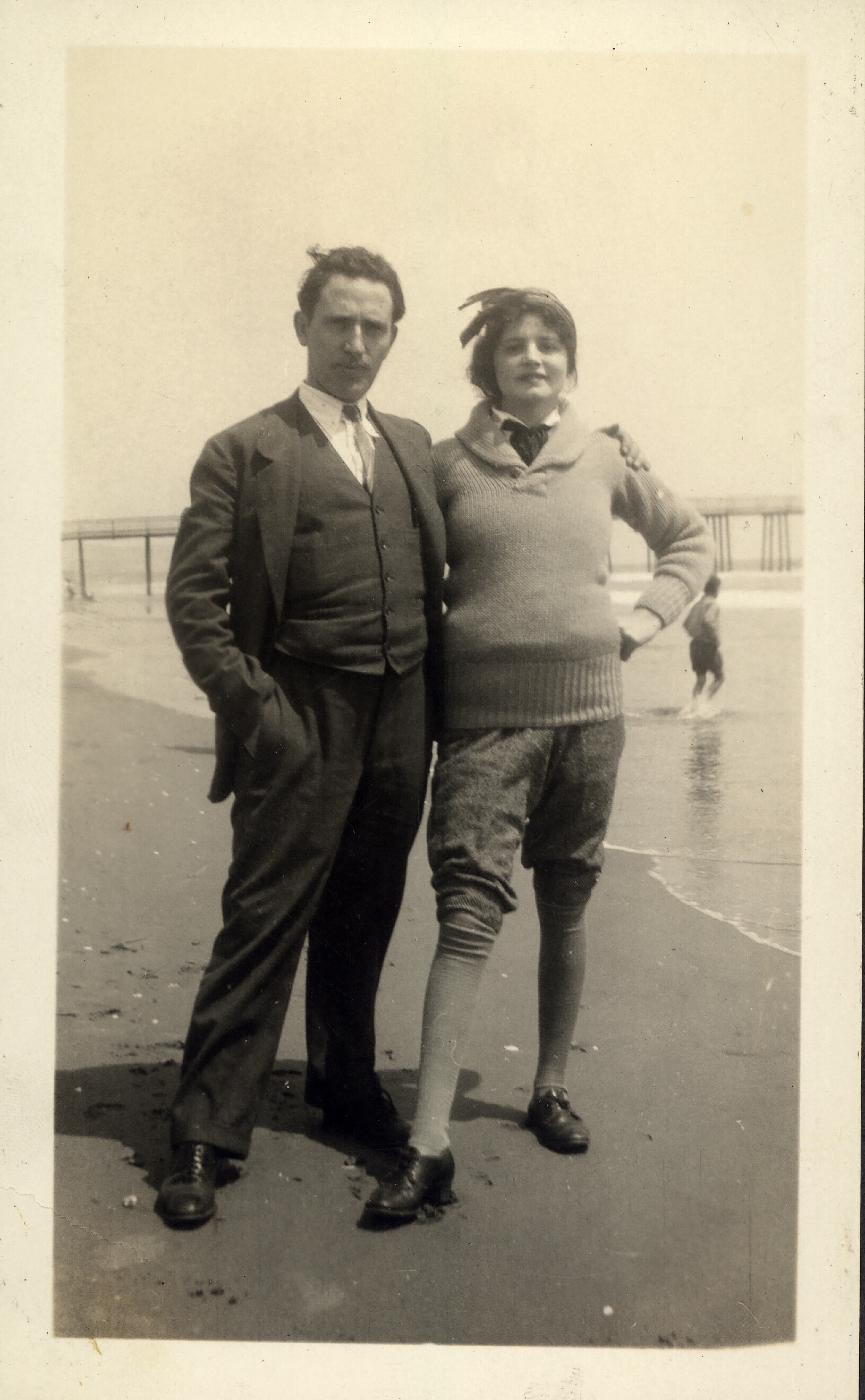 Mom and Dad at Santa Monica Beach. My mother was pregnant at the time. But look at her tie, pants and scarf in her hair.