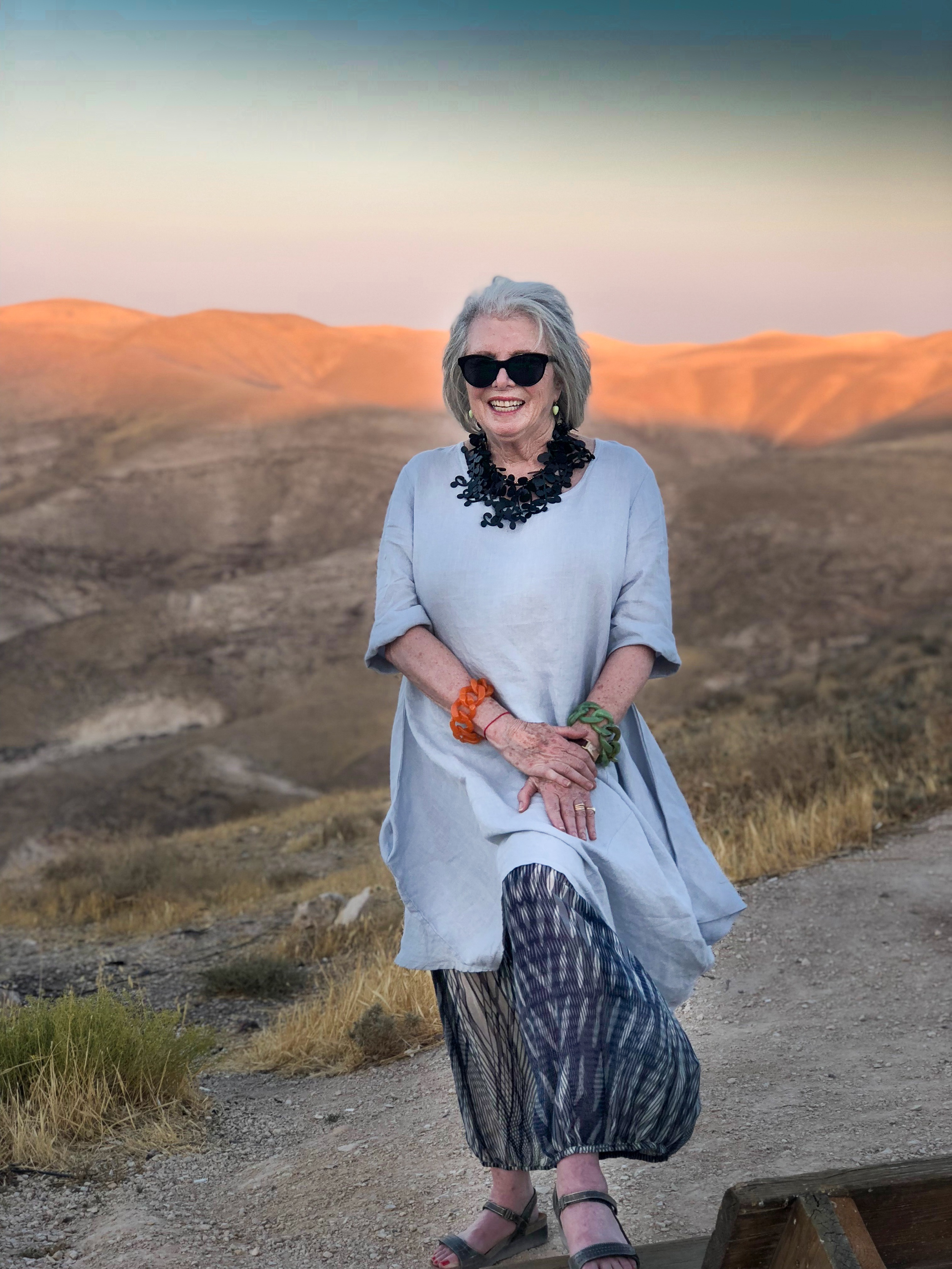 Here I am in Israel on the West Bank, Sandra of the Desert, wearing Warby Parker sun glasses, Ted Muehling earrings, ArtfulHome necklace, Bryn Walker outfit, Angela Caputi bracelets and Naot shoes.