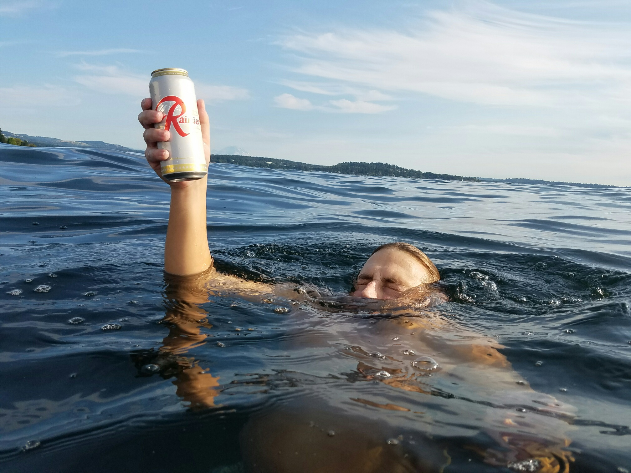 Miles Lippold, motion editor of Soulcraft Allstars underwater holding beer